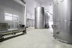 Modern wine cellar with stainless steel tanks Royalty Free Stock Images