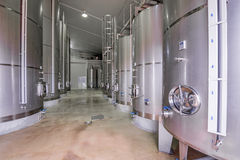 Modern wine cellar with stainless steel tanks Royalty Free Stock Photography