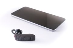 Modern wireless bluetooth headset and smartphone Stock Photo