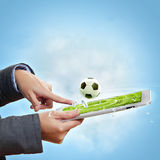 Touch screen computer device and ball Stock Photography