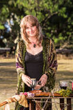 Modern Witch with Goblets. Smiling adult in outdoor pagan ritual practice Stock Photography
