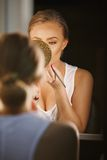 Modern woman applying makeup Royalty Free Stock Photos