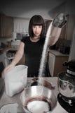Modern woman baking Stock Image