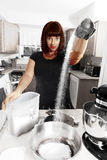 Modern woman baking Stock Images