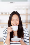 Modern woman drinking a cup of coffee Stock Photography