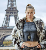 Modern woman in front of Eiffel tower in Paris, France Stock Photo