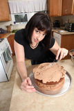 Modern woman frosting cake Stock Image