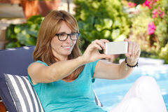 Modern woman in garden Stock Photos