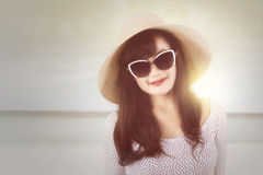 Modern woman with hat at coast Stock Image