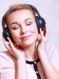 Modern woman with headphones listening music Stock Image