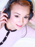Modern woman with headphones listening music Stock Photography