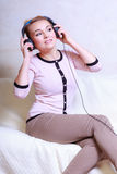 Modern woman with headphones Stock Images