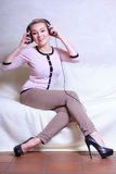 Modern woman with headphones listening to music Royalty Free Stock Photography