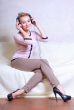 Modern woman with headphones listening to music Stock Photo