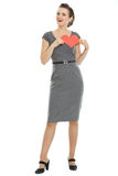 Modern woman holding heartshaped postcard Royalty Free Stock Photos