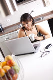 Modern woman reading e-mails at her breakfast Royalty Free Stock Images