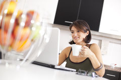 Modern woman reading e-mails at her breakfast Stock Images