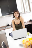 Modern woman reading e-mails at her breakfast Royalty Free Stock Photos