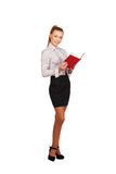 Modern woman with red book in hands  full growth. Young woman with red  book in her hand, full growth isolated on white Stock Image