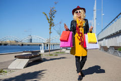 Modern woman after shopping Royalty Free Stock Photo