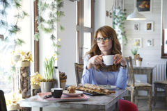 Modern woman sitting in coffee shop Stock Image