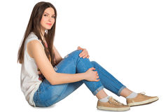 Modern woman sitting on floor isolated. Modern smiling woman sitting on floor isolated stock photo