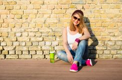 Hipster woman sitting on the ground Stock Photography