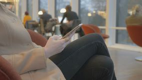 Modern woman texting sms on a smartphone stock video