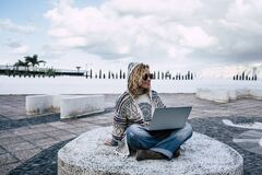 Free Modern Woman Travel Outdoor With Technology And Internet Connection Ona Laptop Computer And Roaming - People And Digital Nomad Stock Photo - 190302560