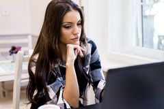 Modern woman websurfing in cafe Stock Photo