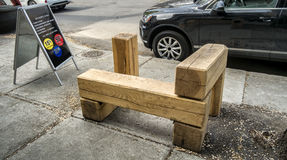 Modern Wood bench. Public modern wood bench in front of a store stock photos