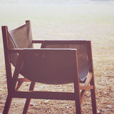 Modern wood chair in the garden with retro effect Royalty Free Stock Image