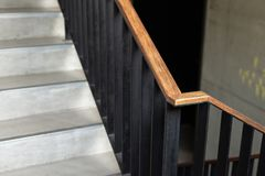 Modern wood handrail in the building - design/interior. Modern wood handrail in the building - design / interior royalty free stock images
