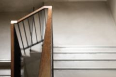 Modern wood handrail in the building - design/interior. Modern wood handrail in the building - design / interior royalty free stock photo