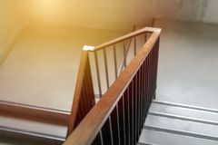 Modern wood handrail in the building - design/interior. Modern wood handrail in the building - design / interior royalty free stock image