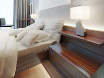 Modern wooden bedside nightstand in the form of shelves. Stock Image