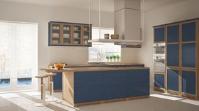 Modern wooden and blue kitchen with island, stools and windows, parquet herringbone floor, architecture minimalistic interior desi. Gn stock photography