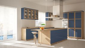 Modern wooden and blue kitchen with island, stools and windows, parquet herringbone floor, architecture minimalistic interior desi. Gn royalty free stock photo