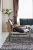 Modern wooden chair in living room. At home Stock Images