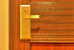 Modern wooden door with handle Royalty Free Stock Photography
