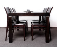 Modern wooden finished dining table. With six chair set Stock Image
