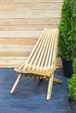 Modern wooden folding deckchair concept. Design interior hardwood garden chair Stock Image
