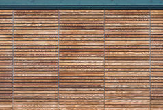 Modern wooden gate made of slats. Modern gate made of many strips of wood Stock Photos