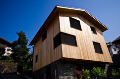 Modern wooden house in Italian Alps Stock Image
