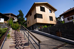 Modern wooden house in Italian Alps Stock Image