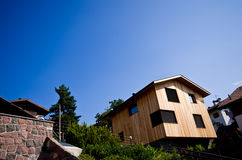 Modern wooden house in Italian Alps Stock Images