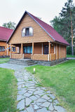 Modern Wooden House Made of Logs Royalty Free Stock Photo
