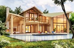 Modern wooden house with pool. Modern wooden house with swimming pool royalty free stock photography