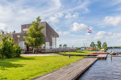 Modern wooden marina building royalty free stock image