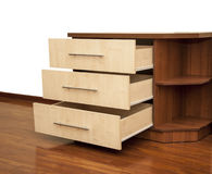 Modern wooden nightstand. On the floor in bedroom Royalty Free Stock Photography